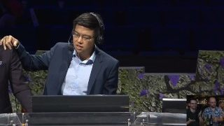 Dota 2 caster Blitz is doing something naughty under the table at TI9