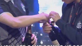 OG cheers with champagne after winning TI9