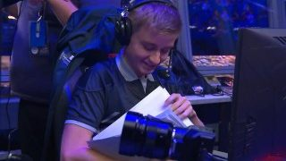 The perfect flower OG.N0tail looks at his papers at TI9 PSG.LGD vs OG